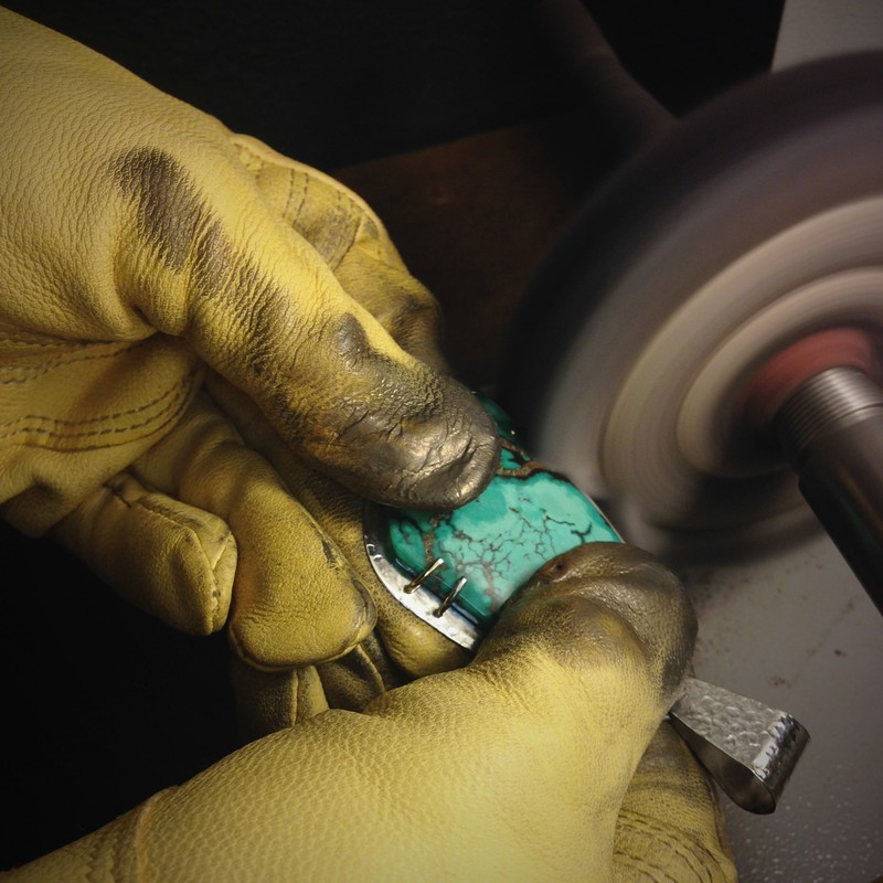 buffing a turquoise and sterling silver pendant | FSG Fine Jewelry | Salado, TX